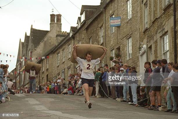 Traditional annual wool sack race test of strength in Tetbury Gloucestershire World culture Competition Contest