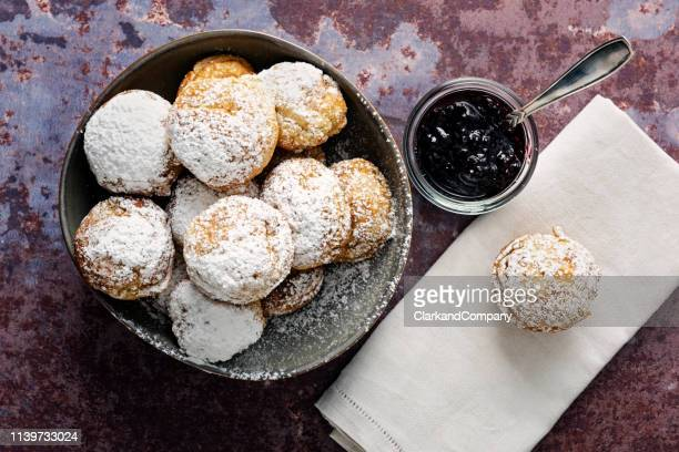 traditional apple pancakes or aebleskiver in danish. - icing sugar stock pictures, royalty-free photos & images
