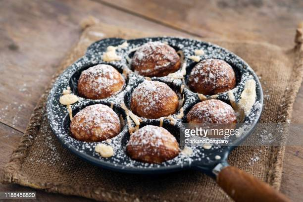 traditional apple pancakes or aebleskiver in danish. - danish culture stock pictures, royalty-free photos & images