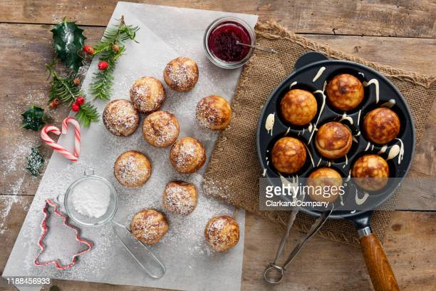 traditional apple pancakes or aebleskiver in danish. - tradition stock pictures, royalty-free photos & images