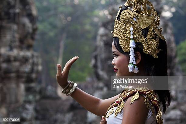 CONTENT] Traditional Apsara dancer performing at the Bayon Temple in Angkor Wat Cambodia