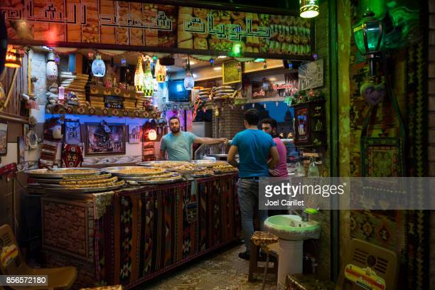 traditional arab sweets shop in erbil, iraq - kurdish ethnicity stock pictures, royalty-free photos & images