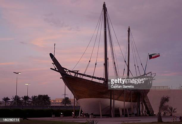 traditional arabic boat (dhow) - kuwait city stock photos and pictures