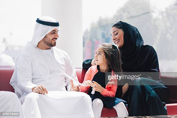 traditional  arabic family enjoying at lounge - united arab emirates stock pictures, royalty-free photos & images