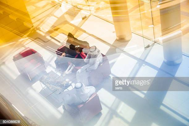 traditional  arabic family enjoying at lounge - dubai airport stock photos and pictures