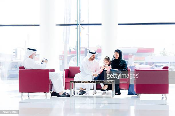 Traditional  Arabic family enjoying at lounge