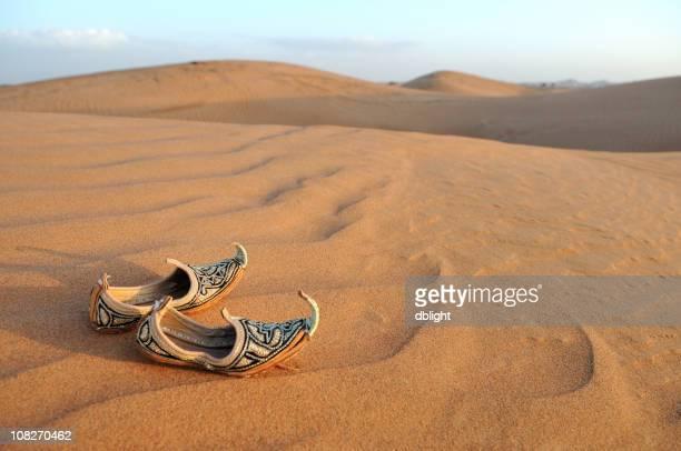 Traditional Arabic Sandals on Desert Sand Dunes