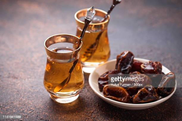 traditional arabic tea and dry dates - iftar stock pictures, royalty-free photos & images