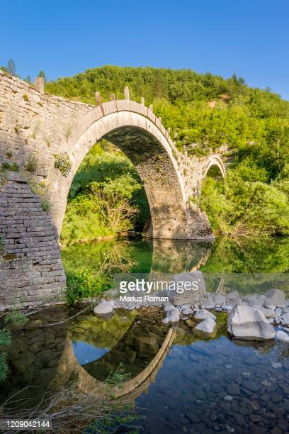 traditional arched stone bridge of zagori region, greece. europe. - epirus greece stock pictures, royalty-free photos & images