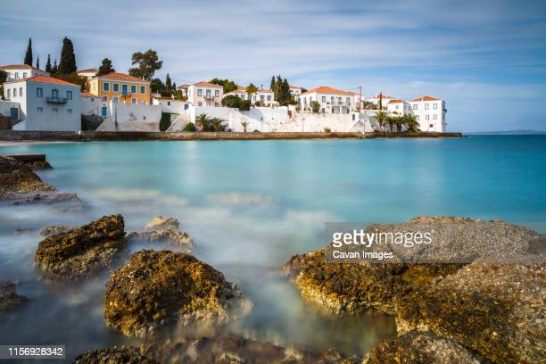 traditional architecture in spetses seafront, greece. - spetses stock pictures, royalty-free photos & images