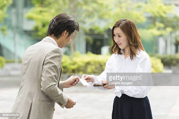 Traditional Asian Bowing and Exchange of Business Cards Tokyo Japan