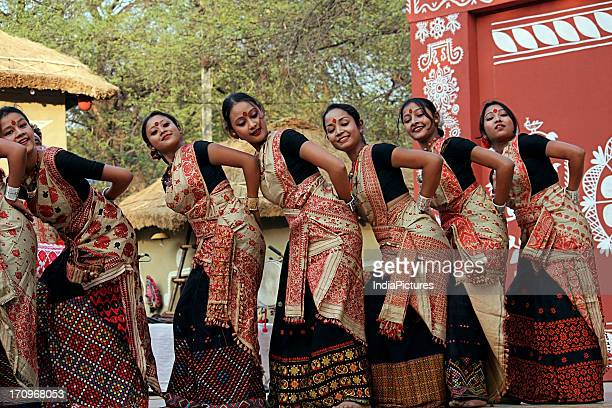 Traditional Assamese dancers perform the Bihu dance at the Surajkund Crafts Mela in Faridabad Haryana India