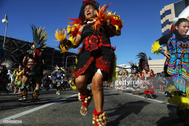 Traditional Aztec dancers march in a parade marking Mexican Independence Day on September 16 2018 in Santa Ana California 116 million immigrants from...