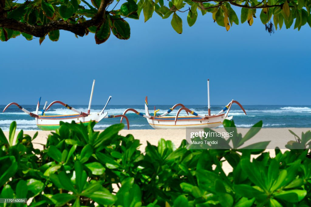 Traditional balinese jukung fishing boats on Nusa Dua beach, Bali : Foto stock
