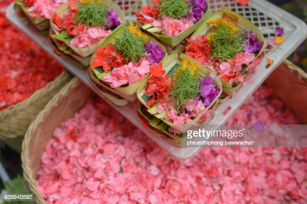 Traditional balinese offerings to gods in Bali with flowers.