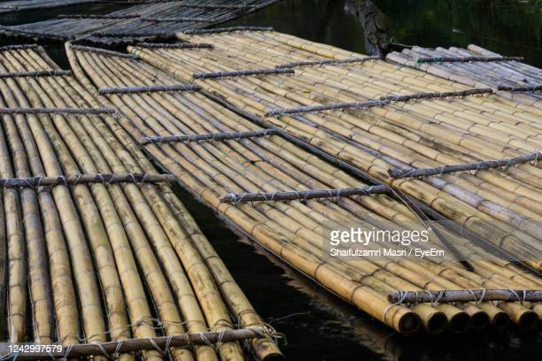 traditional bamboo rafts - shaifulzamri stock-fotos und bilder