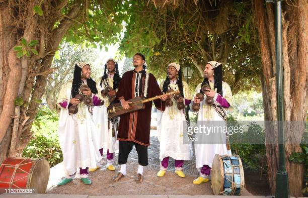 A traditional band perform as Prince Harry Duke of Sussex and Meghan Duchess of Sussex walk through the walled public Andalusian Gardens which has...