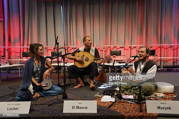 A traditional band performs on stage ahead of the inter religious midday prayer at the 35th German Protestant Church Congress Believers from several...