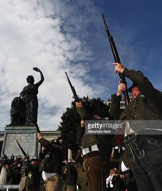 Traditional Bavarian riflemen and shoot during a parade in front of the famouse scupture called 'Bavaria' during the Oktoberfest at Theresienwiese on...