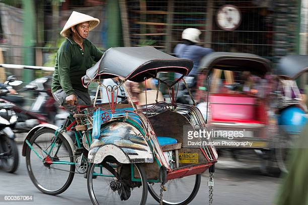 traditional becak - yogyakarta stock pictures, royalty-free photos & images