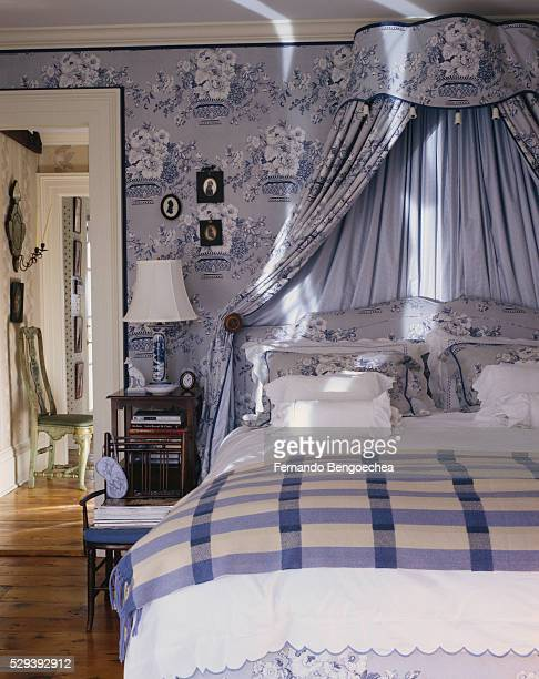 traditional bedroom in blue - fernando bengoechea stock pictures, royalty-free photos & images
