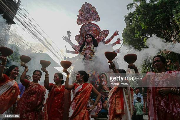 Traditional Bengali ritual before immersion 'Sindur khela' or playing sindur and Dhunuchi Dance at Durga Puja time n this occasion Bengali women...