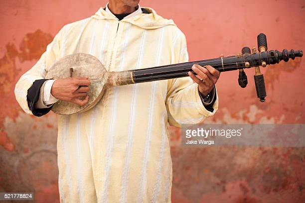 traditional berber string instrument - jake warga stock pictures, royalty-free photos & images