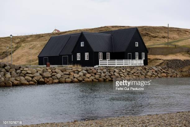 traditional black wooden house at hofsós, northwest iceland - tradition fotografías e imágenes de stock