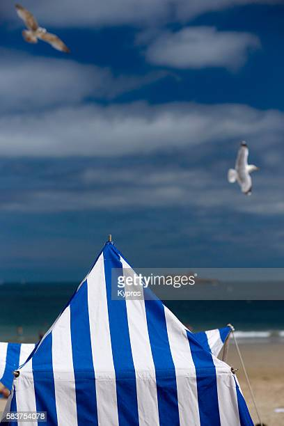 Traditional Blue And White Striped Tents On The Beach