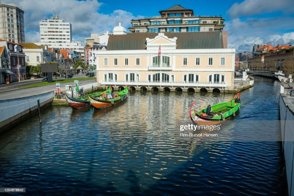 Traditional boats on the canal in Aveiro : Stock Photo