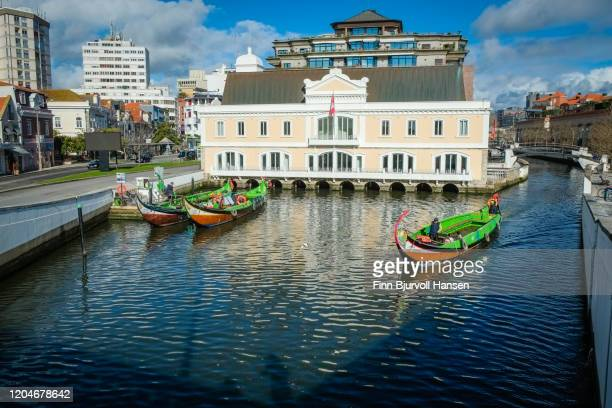 traditional boats on the canal in aveiro - finn bjurvoll stock pictures, royalty-free photos & images
