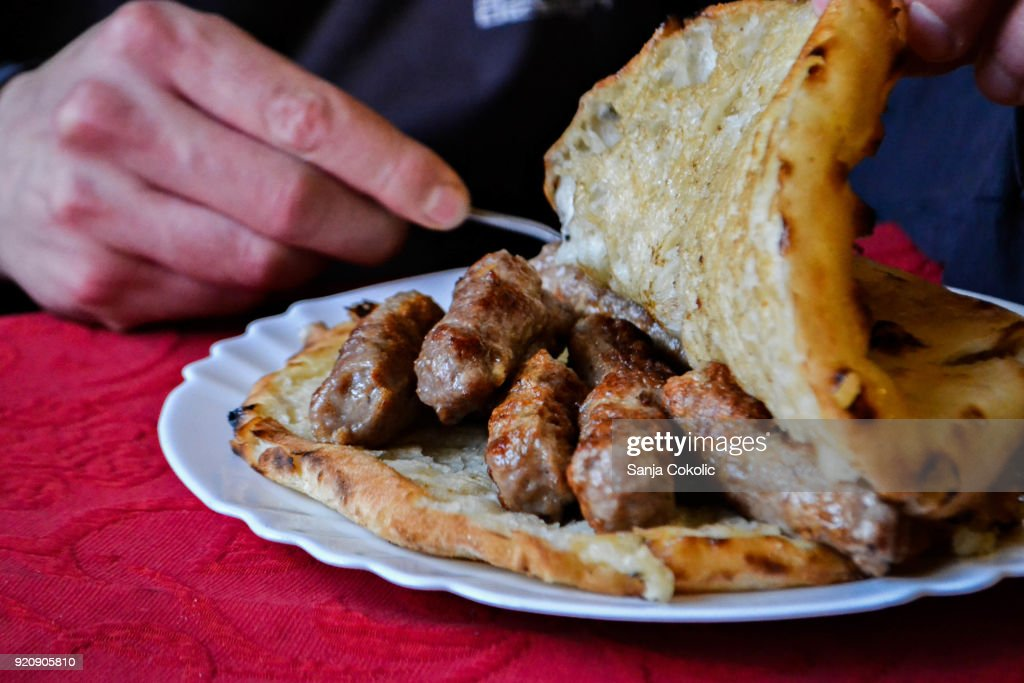 Traditional Bosnian and Balkans food, meat in bread, cevapi : Stock Photo