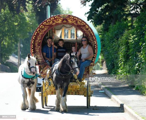 A traditional bow top caravan arrives in town on the first day of the Appleby Horse Fair on June 7 2018 in Appleby EnglandThe fair is an annual...