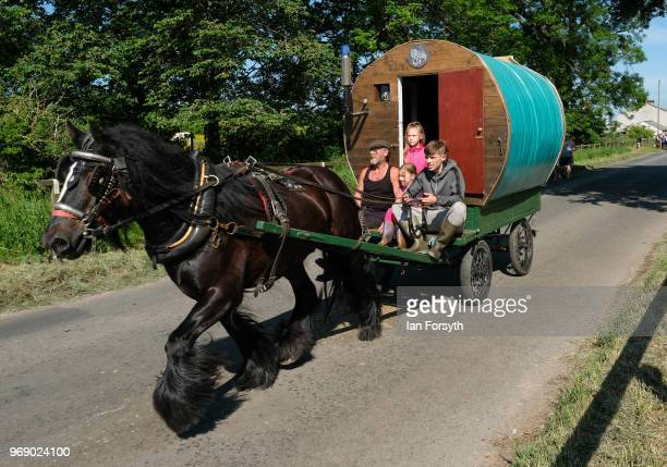 A traditional bow top caravan is driven to the campsite on the first day of the Appleby Horse Fair on June 7 2018 in Appleby EnglandThe fair is an...