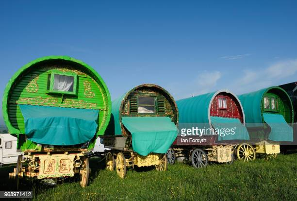 Traditional bow top caravans are lined up on a campsite on the first day of the Appleby Horse Fair on June 7 2018 in Appleby EnglandThe fair is an...