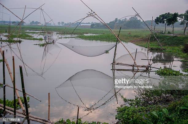 traditional box fishing net - fishing in bangladesh stock photos and pictures