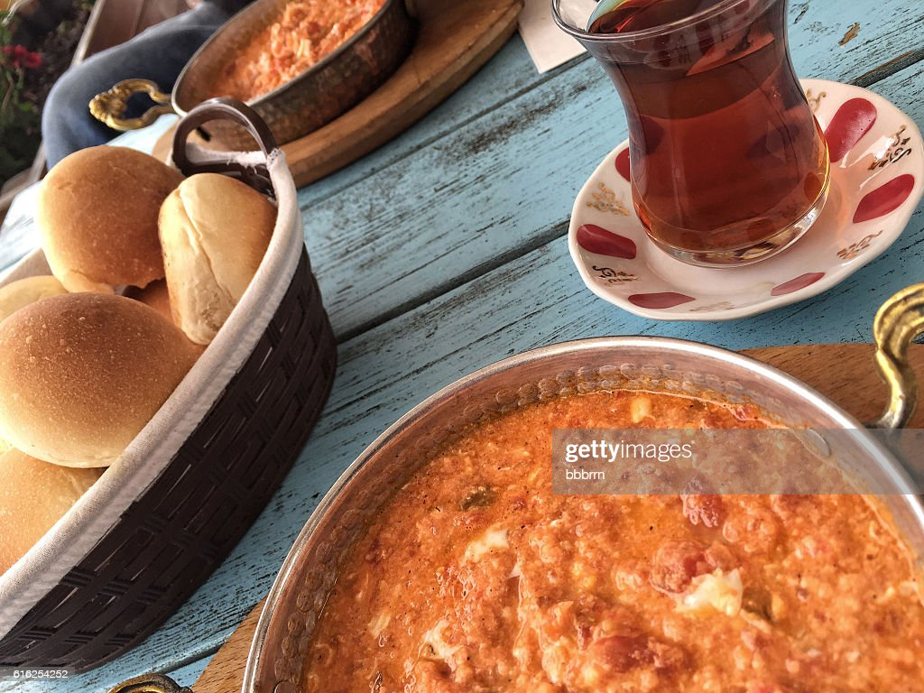 traditional breakfast with omelet and turkish tea on wooden tabl : Stock Photo