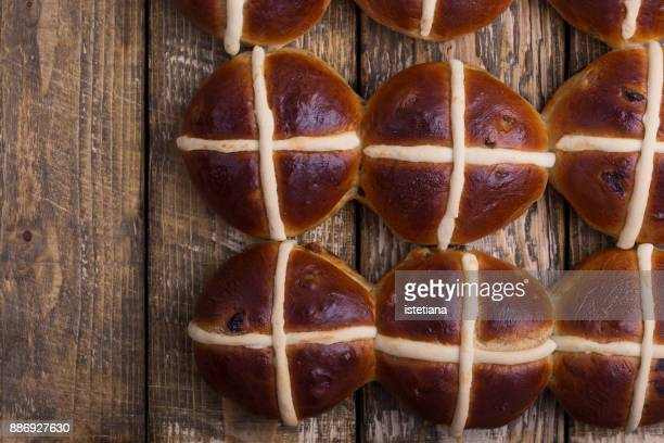 traditional british dishes. easter hot cross buns - hot cross bun stock pictures, royalty-free photos & images