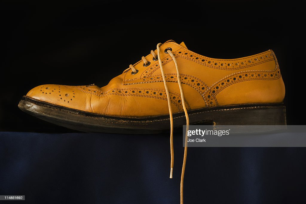 Traditional brogue on black background : Stock Photo