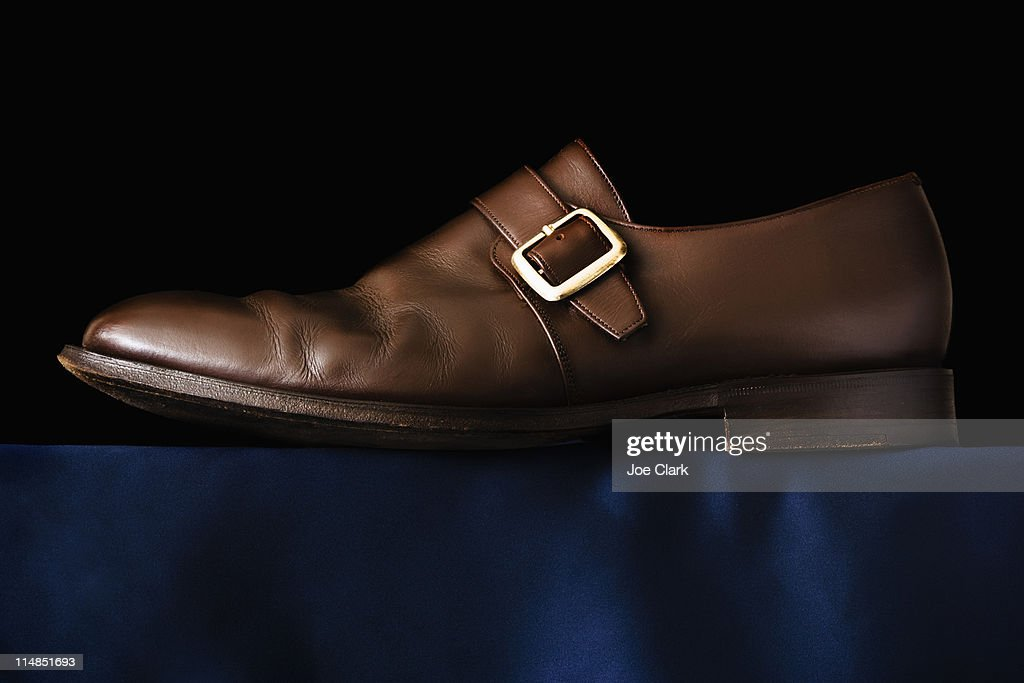 Traditional Buckle shoe on black background : Stock Photo