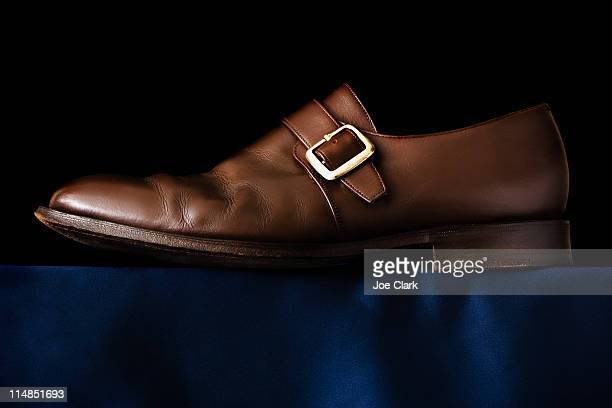 Traditional Buckle shoe on black background