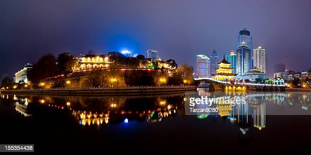 traditional building in front of modern skyscrapers - guiyang stock pictures, royalty-free photos & images