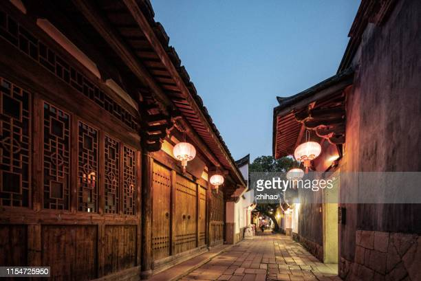 traditional buildings in fuzhou at night, with lanterns - fuzhou stock pictures, royalty-free photos & images