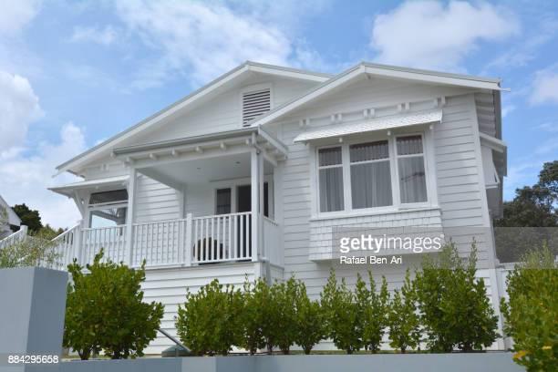 traditional bungalow house low angle side view - rafael ben ari stock-fotos und bilder