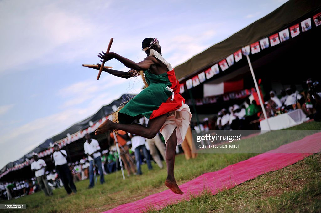 A traditional Burundian drummer leaps during a dance in a political rally for the ruling party at a sports field in Bujumbura on May 11, 2010. Some 3.5 million registered voters will go to the polls to elect 1,935 municipal counselors across the country on May 20th in what experts agree will be a catlyst for the soon to follow Legislative and Presidential elections. This elections will be the fist all inclusive elections since a peace accord ended a bloody 13 year civil war in 2006. The French government has provided Burundi with 90,000 euros to organize the upcomming elections.