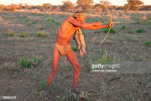 Traditional bushmen with traditional clothes and weapons