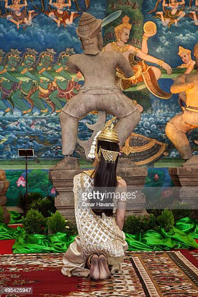 A traditional Cambodian Apsara dancer performs in front of the Duryodhana statue during a ceremony to handover three statues back to Cambodia at the...