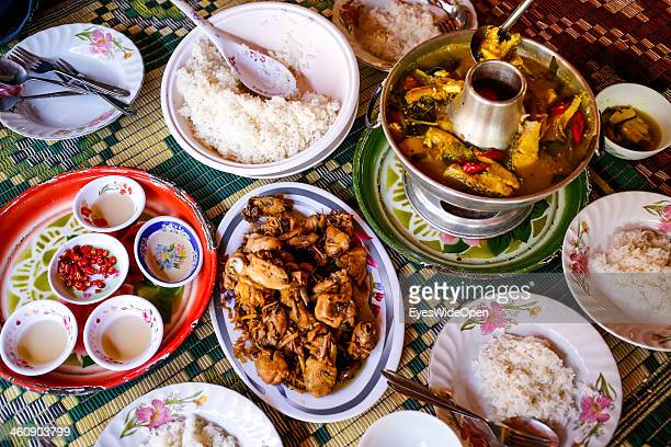Traditional cambodian cuisine sour fish soup chicken and rice in a street restaurant at mountain Phnom Udong about 40 km northwest of the capital...