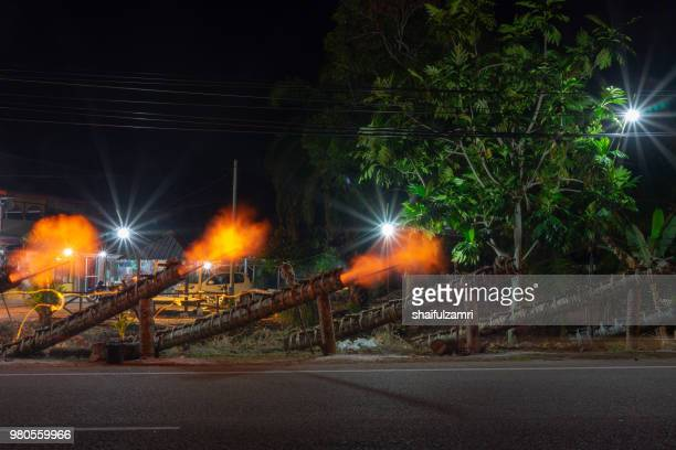 Traditional cannon made from coconut palm tree light up during the celebration of Eid-Mubarak.