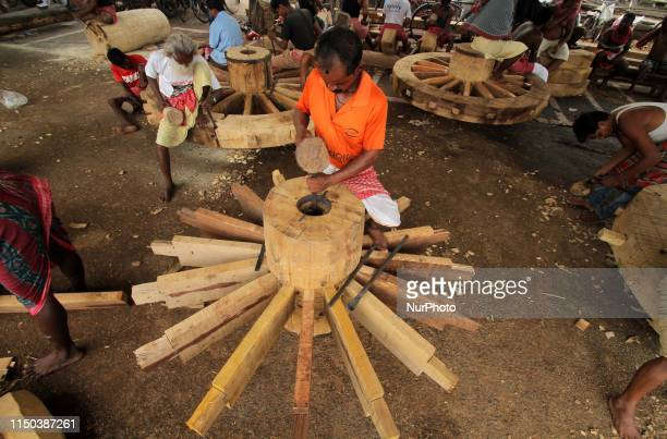 Traditional carpenters are seen as they are busy to build wooden wheels of ditties chariots ahead of the Lord Jagannath's annual chariot festival or...